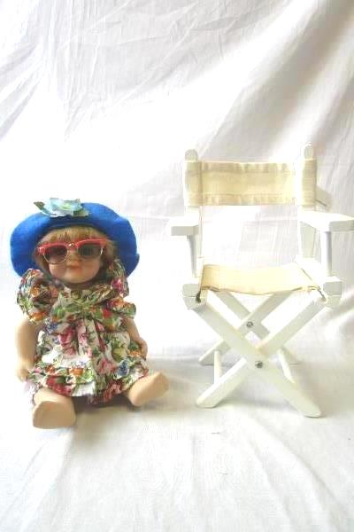 Multi-Colored Beach Themed Porcelain Doll With Glasses Hat And Beach Chair