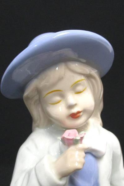 Porcelain Girl Figurine Holding Flower Eyes Closed Sweet Face Lilac Dress Hat