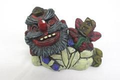 2010 Seto Craft Figurine Folk Art Reclining Man Holding A Red Flower