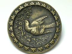 Antique Brass Metal Shank Button Featuring A Dove And Flowers 1 3/8 Inch