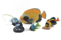 Lot of 4 Tropical Fish Tabletop Figurines and 1 Polished Tumbled Shark Stone