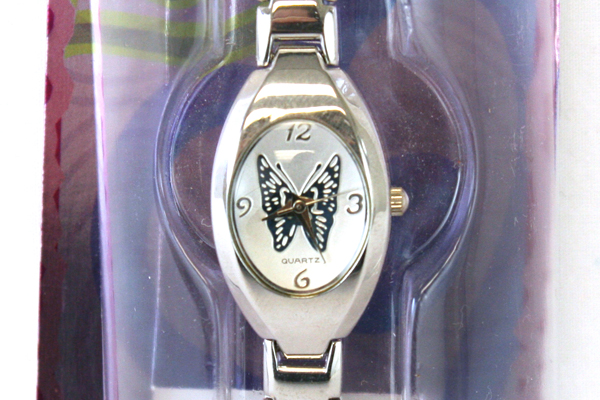 Silvertone CURFEW Wrist Watch With White Face And Blue Butterfly