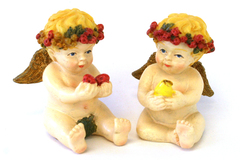Pair Of Ceramic Boy And Girl Cherubs Holding Fruit